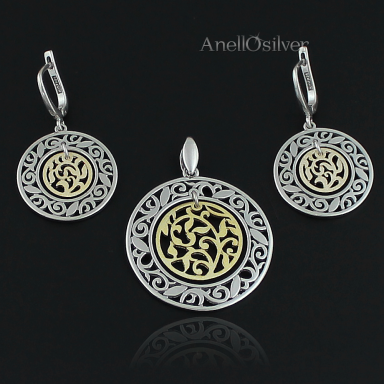Silver jewelery set with  moving the center plated with 24 carat gold.